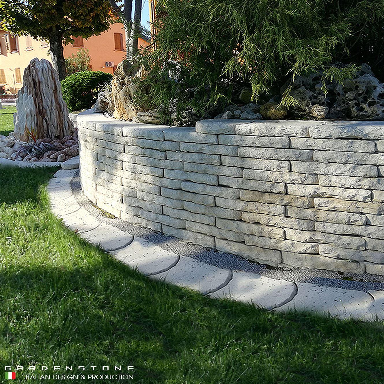 Muretto in finta pietra circolare aiuole di grandi dimensioni rialzate