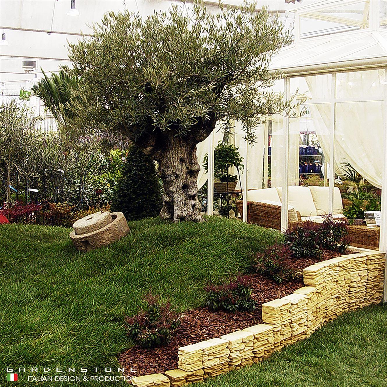 Muretto a scalare in finta pietra per giardino
